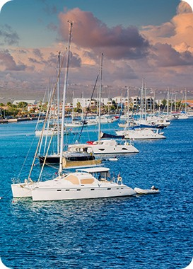 Boats on the waters of Bonaire. See the beautiful Bonaire destinations that Maduro Travel has to offer and discover Bonaire.
